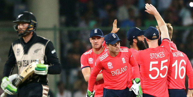 England players celebrate the dismissal of New Zealand's Martin Guptill. photo / AP