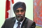 Audrey Young speaks with Canada's Minister of National Defence, Harjit Sajjan.
