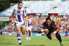 Solomone Kata scores against the Newcastle Knights. Photo / Getty