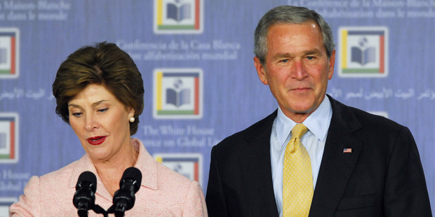 Laura Bush and George W. Bush speak at the White House Literacy Conference. Photo / Getty Images