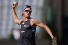New Zealand's Adam Milne throws a ball during a practice session ahead of the semifinal against England. Photo / AP