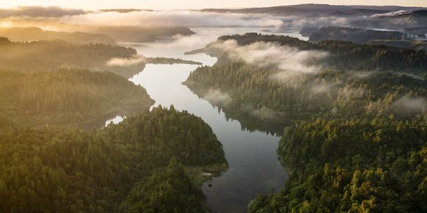 Sunrise at Lake Rotoehu. Low clouds make for a stunning shot of the landscape. Drone photograph by Stephen Parker.