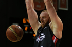 Gareth Dawson of the Canterbury Rams with a slam dunk against the Southland Sharks. Photo / Photosport