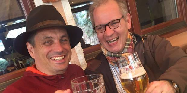 Winston Aldworth celebrates his new hat with a friendly beer with a local tour guide.