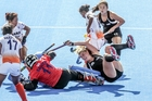 Black Sticks striker Olivia Merry takes a tumble during the 1-0 win against India. Photo / Paul Taylor