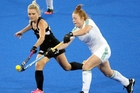 Black Sticks player Charlotte Harrison keeps Irishwoman Zoe Wilson in check. Photo / Paul Taylor