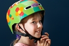 FLOWER POWER: Mia Olsen, 8, one of the Travel Safe Design your Own Helmet competition winners, models her helmet. PHOTO/ANDREW WARNER