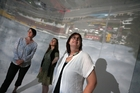 Diane Stoppard (left), Felicity Christian and Trish Clark admire Pak'n Save from a trial camera obscura they made in Whangarei's old Harbour Board Building. Photo / Michael Cunningham