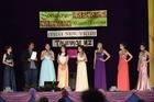 Eight women competed in the 2016 Miss Songkran Beauty Pageant. Mookthida Latsamy (in purple) won. Photo / George Novak
