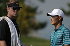 Danny Lee and caddie Kurt Kowaluk at The Presidents Cup last year. Photo / Getty Images