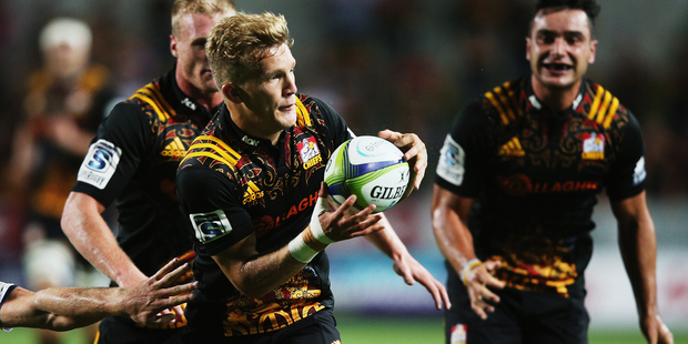 The promotion of players like Damian McKenzie shows rugby rule changes are misguided. Photo / Getty