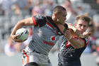 Warriors wing Tui Lolohea is collared by the Roosters' defence. Photo/Getty.