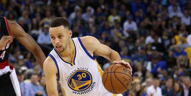 Stephen Curry dribbles the ball against the Portland Trail Blazers. Photo / Getty Images