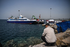 Turkish ferry carrying a second group of migrants deported from Greece to Turkey arrives at the port of Dikili district in Izmir on April 8, 2016. Photo / Getty Images