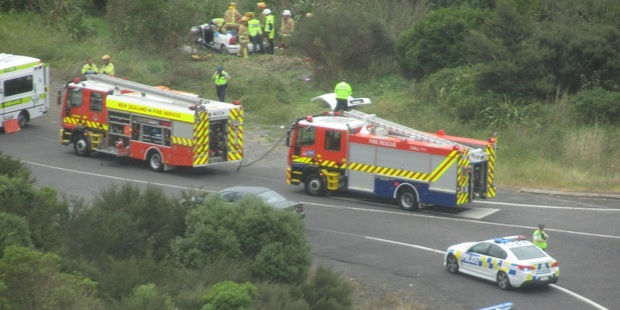 The car crashed into a sign, veered through a fence and came to a stop in a small ditch in Mangatawhiri Photo / Auckland Rescue Helicopter Trust