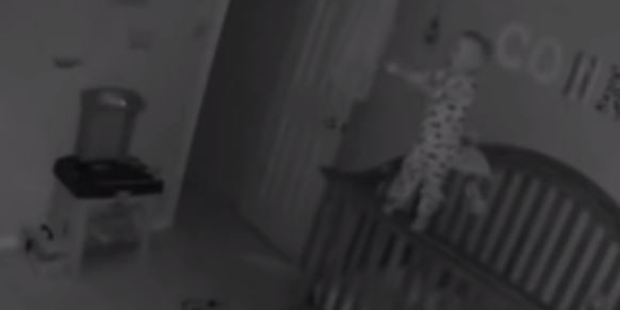 While some were quick to shun the idea of paranormal activity, many believe the footage of the child pulling himself up to stand on the railing of his cot is genuine. Photo / YouTube, Chris and Keelan Chronicles
