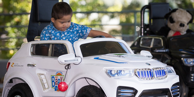 Loading Jonathan Martin who has Down syndrome test drives his new 'Go Baby Go' car at BMW. Photo / Greg Bowker