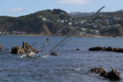 The yacht which sank after hitting rocks at Moa Point, near Wellington International Airport. Photo / Mark Mitchell