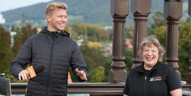 Loading TV One Breakfast's Matt Gibb doing the live weather cross with Rotorua Museum's Julie Parsons on the roof of the museum this morning.  Photo/Ben Fraser