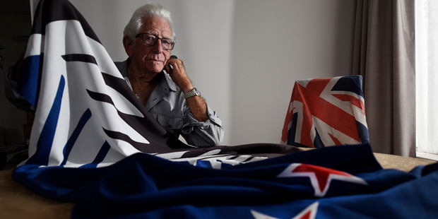 """Brian Cotter, 86, held a """"loser's party"""" to take down the silver fern flag after it was narrowly defeated in the referendum. Photo / George Novak"""