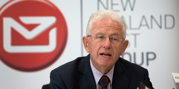 Loading New Zealand Post Group chairman Sir Michael Cullen announcing the company's decision to sell-off part of Kiwibank during a press conference in Wellington. Photo / Mark Mitchell