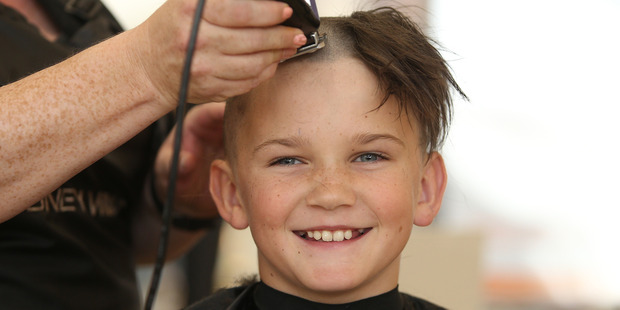 Loading Oscar Maybury, 9, shaves his hair a second time for cancer. Photo/John Borren