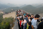 Tourists pose for photographs at The Great Wall near Beijing, China. Photo / Adam Dean
