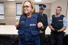 Corrections Minister Judith Collins wearing a stab-proof vest during a safety equipment demonstration. Photo / Mark Mitchell