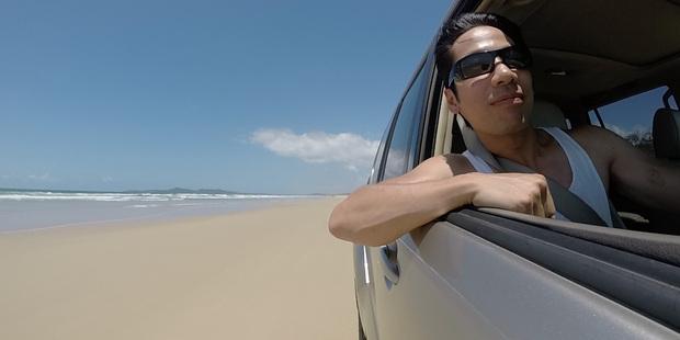 Loading The writer drives down Teewah Beach, Sunshine Coast. Photo / Andrew Louis
