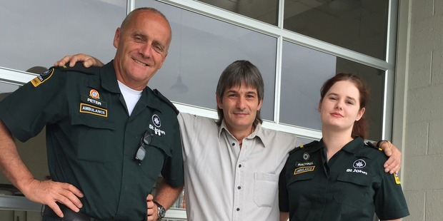 Loading Andrew Jones (centre), with paramedics Peter Holloway and Rachael Wallen. Photo / Cherie Howie