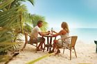 You can eat on the beach  at Waterline. Photo / Cook Islands Tourism