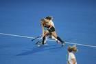 Black Sticks women's player, Rose Keddell, passes the ball under pressure from Elena Tice, of Ireland, in Hastings tonight. PHOTO/Paul Taylor