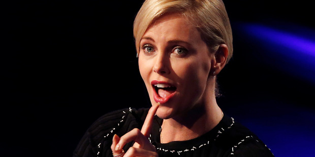 Charlize Theron says her comments to GQ were taken out of context.