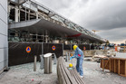 In this March 23, 2016 file photo, a forensics officer works in front of the damaged Zaventem Airport terminal in Brussels. Photo / AP