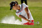Lydia Ko, of New Zealand, hits from the bunker on the 12th hole. Photo / AP.