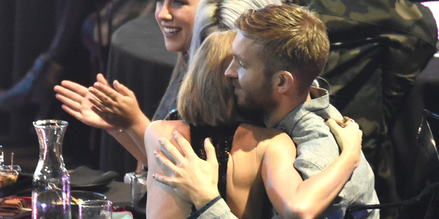 Taylor Swift hugs Calvin Harris after she was announced as the winner of the female artist of the year award during the iHeartRadio Music Awards. Photo / AP