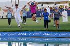 Kiwi Lydia Ko and her caddie Jason Hamilton jump into Poppie's Pond after winning the LPGA Tour ANA Inspiration major. Photo / AP