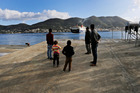 Refugees at the port of the eastern Greek island of Samos, where tourist bookings are in decline. Photo / AP