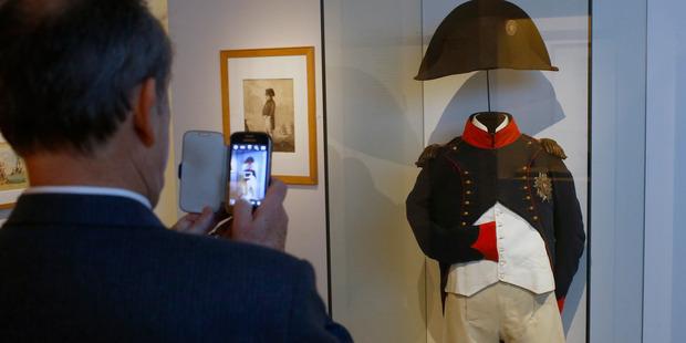 A visitor photographs Napoleon's uniform. Photo / AP