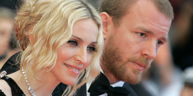 Madonna and her then husband director Guy Ritchie have been involved in a bitter custody battle. Photo / AP
