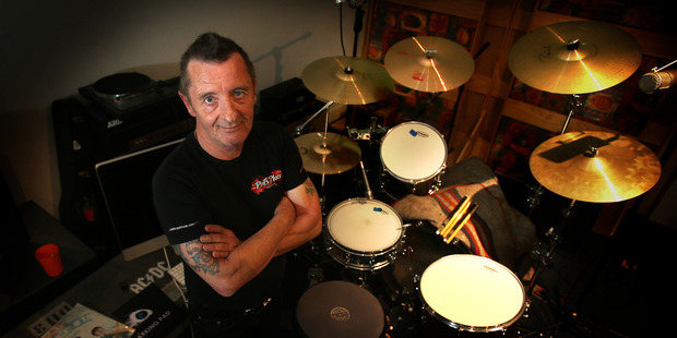 AC/DC rocker Phil Rudd has been named one of the world's greatest drummers of all time, and still enjoys playing a few solos in his Matua home.