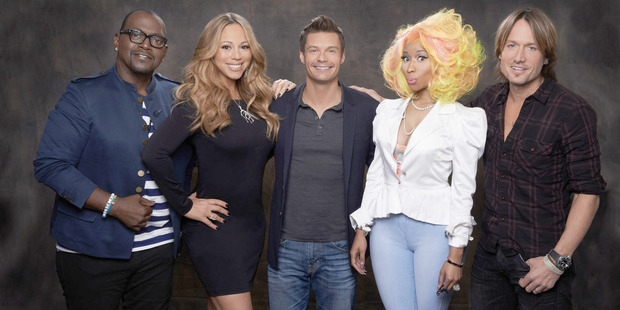 American Idol host Ryan Seacrest (centre) is flanked by troubled judges Randy Jackson, Mariah Carey, Nicki Minaj and Keith Urban.
