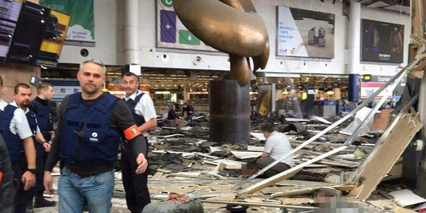 A scene of carnage inside the departure hall of Brussels airport after 2 explosions ripped through the building. Photo / Twitter