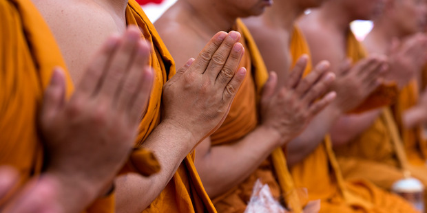 At Thai New Year the Buddha is bathed at a shrine before water is poured over the hands of monks and elders. Photo / Brett Phibbs