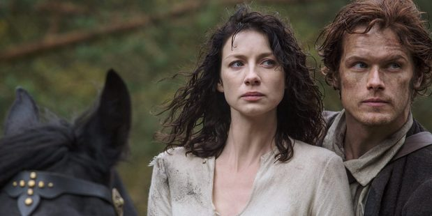 Claire Randall played by Caitriona Balfe and Jamie Fraser played by Sam Heugan in their early courting days.