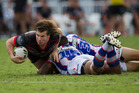 Charlie Gubb stretches for the try line against the Newcastle Knights. Photo / Nick Reed