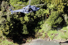 An RNZAF NH90 helicopter was brought in to lift a vehicle out of the Mohaka river near Raupunga after it plunged off state highway 2 on Saturday killing three men in November last year. PHOTO FILE