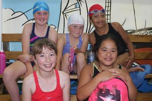 Huia Range students waiting their turn in the pool. Back: Chloe Hansen (left), Sally Peffers and Tiarah Glanville. Front: Paige Withey (left) and Okeroa Mason-Kiu.