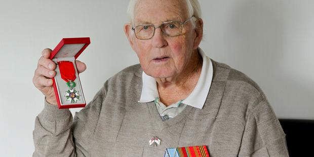 Napier veteran John Whitehead (left) with his Legion of Honour medal. Photo / Warren Buckland