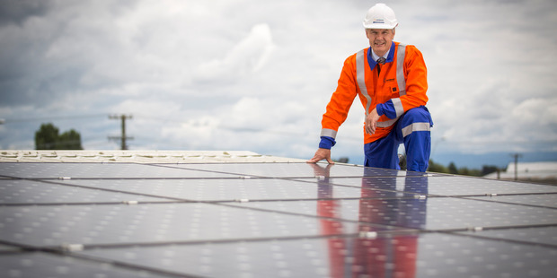Unison Networks chief executive Ken Sutherland is pictured with solar panels. Photo John Cowpland/Alphapix